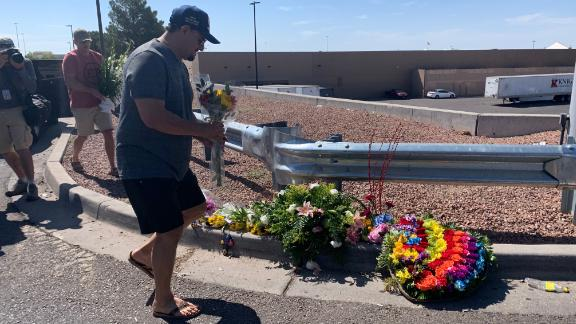 Alfredo Angcayan, 62, an Air Force veteran, brought a bouquet of flower to a growing memorial a few yards away from the Walmart store in El Paso, TX, where 20 people were killed in a shooting on August 3, 2019.