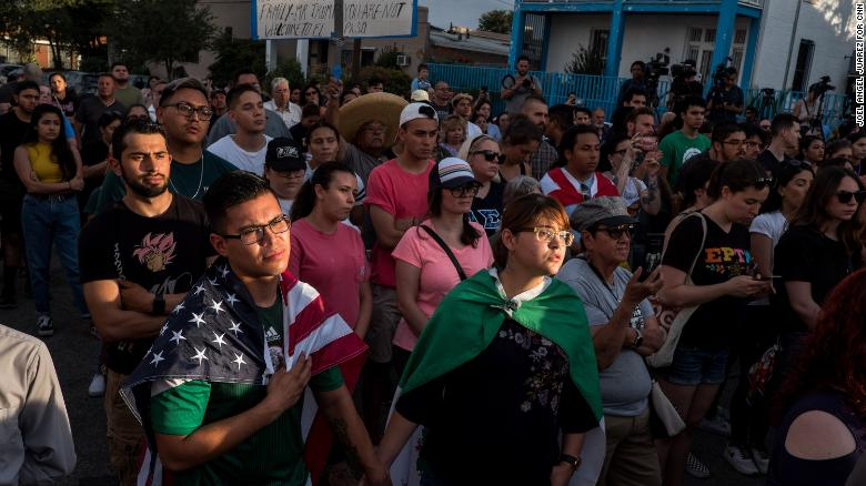 Cesar Antonio Pacheco, 24, left, and Samantha Ordaz, 20, both of El Paso, hold hands during a vigil.