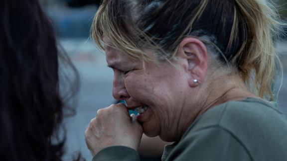 Edie Hallberg speaks to reporters near the site of the El Paso Walmart where people were killed Saturday. Hallberg