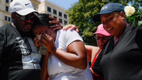 Mourners gather at a vigil in Dayton.