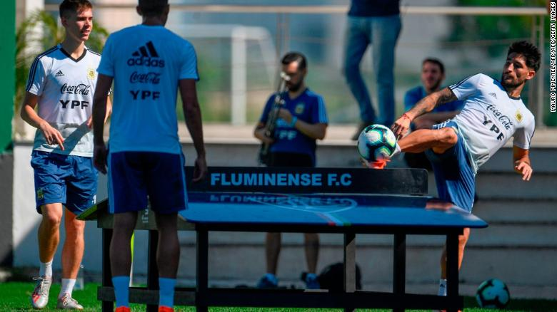 Argentina's players Juan Foyth (L) and Milton Casco (R) play teqball during a training session in Rio de Janeiro, Brazil.