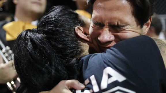 EL PASO, TEXAS - AUGUST 04: Mariachi player and El Paso resident Sebastian Gonzalez (R), hugs a woman at the conclusion of an interfaith vigil for victims of a mass shooting, which left at least 20 people dead, on August 4, 2019 in El Paso, Texas. A 21-year-old male suspect was taken into custody in the city which sits along the U.S.-Mexico border. At least 26 people were wounded. (Photo by Mario Tama/Getty Images)