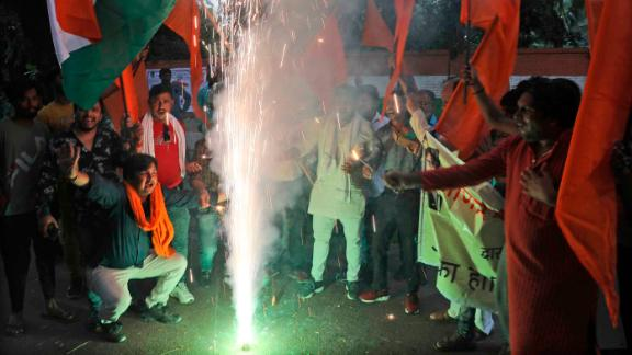 Right wing Hindu groups light firecrackers as they celebrate the removal of Kashmir