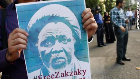 A student holds poster during a protest for the release of Nigerian Shiite leader Ibrahim Zakzaky outside the Nigerian embassy in Tehran on July 17, 2019.