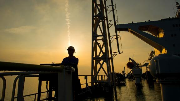 A crew man stands on the deck of the crude oil tanker