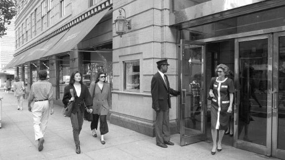 Pedestrians walk past the Barneys store at 7th Avenue and 17th Street in New York, on May 22, 1989.