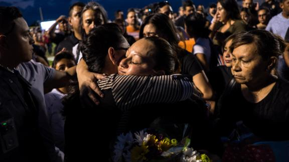 Dina Rodriguez, right, is comforted after attending a vigil for her son, Javier Rodriguez, 15, a sophomore at Horizon High School in Horizon, Texas, Monday, Aug. 5, 2019. Rodriguez was among the 22 killed in the shooting at a Walmart on Aug. 3 in El Paso.