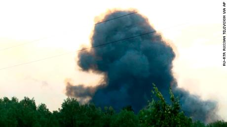 Smoke rises after explosions at a military base near Achinsk, Siberia on Monday, Aug. 5, 2019.
