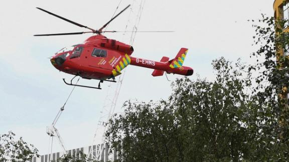 A London Air Ambulance helicopter airlifted the boy from  the Tate Modern gallery on August 4 (Photo by Daniel SORABJI / AFP)        (Photo credit should read DANIEL SORABJI/AFP/Getty Images)