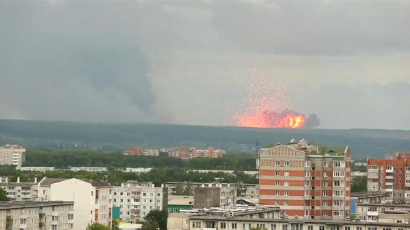 A fire at an arms depot in Siberia caused explosions and at least one death, according to Russian state media.