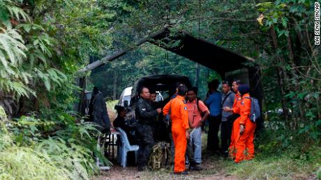 Members of search and rescue teams work at a temporary operation shelter near to The Dusun resort on Tuesday.