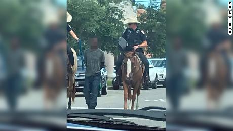Police unions defend mounted officers who escorted a handcuffed man