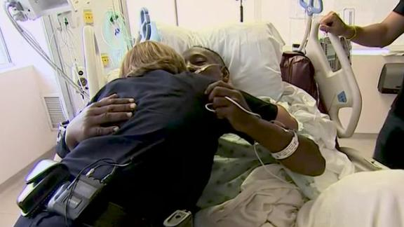 Sifford and Grant embrace two days after the mass shooting.