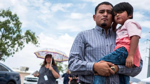 Ivan Flores, 27, an insurances broker in El Paso, Derek, 4, pose for a portrait near the site of the Walmart shooting in El Paso, Texas, Tuesday, Aug. 6, 2019.