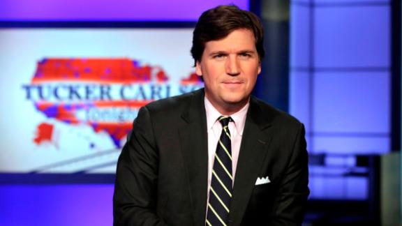 """FILE - In this March 2, 2017, file photo, Tucker Carlson, host of """"Tucker Carlson Tonight,"""" poses for photos in a"""