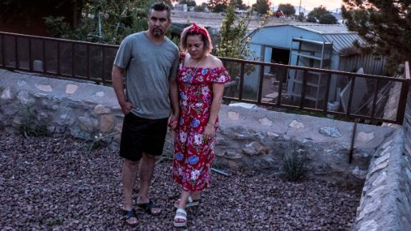 Armando Diaz, a small business owner, and his wife Alma Diaz pose Tuesday outside their home in Socorro, Texas.