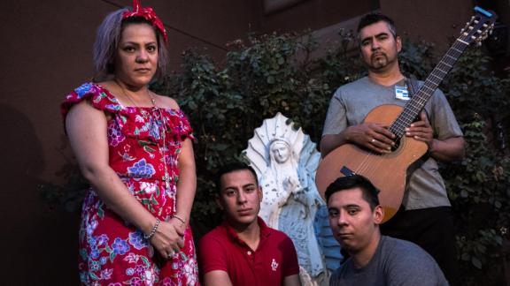 Alma Diaz, 43, left, and her children Daniel, 25, a cashier at Speaking Rock Casino, second from left, Diego, 23, a teacher at the Most Holy Trinity Catholic School, second from right, and her husband Armando Diaz, 43, a small business owner, right, pose for a portrait outside their home in Socorro, Texas, Tuesday, Aug. 6, 2019.