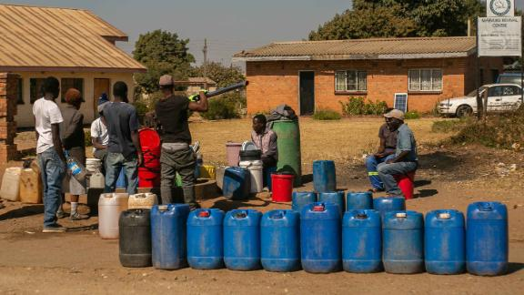 HARARE, ZIMBABWE - AUGUST 01: Members of the public queue for water at a borehole in Tafara on August 1, 2019 in Harare, Zimbabwe. Zimbabwe is facing an acute water shortage after this year's drought, compounded by poor water management. Rainfall is down 25 percent from the annual average, according to the Zimbabwean government, leaving two of Harare's four reservoirs empty. (Photo by Tafadzwa Ufumeli/Getty Images)