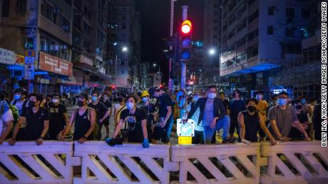 With Hong Kong divided, Beijing tries new tactic to discredit protest movement