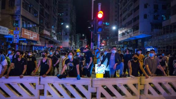 HONG KONG, CHINA - AUGUST 6: Protestors stand off against riot police after a student