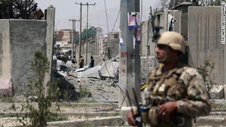 An Afghan security personnel stands guard at the site where a Taliban car bomb detonated at the entrance of a police station in Kabul on August 7, 2019. - Scores of people were wounded when a Taliban car bomb detonated in Kabul on August 7, sending a massive plume of smoke over the Afghan capital and shattering windows far from the blast site. (Photo by STR / AFP)        (Photo credit should read STR/AFP/Getty Images)