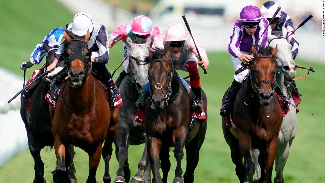 Popular Italian jockey Frankie Dettori rode Too Darn Hot (center, pink) to win the showpiece Qatar Sussex Stakes at Goodwood.