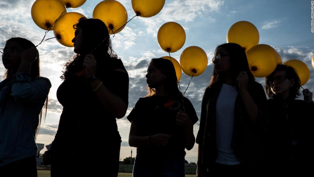 El Dorado High School students attend a ceremony Wednesday, August 7, honoring those who died in the mass shooting in El Paso, Texas.