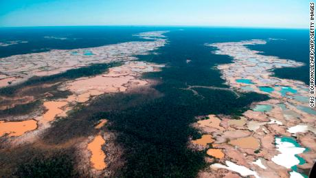Land degradation, including deforestation, produces almost a quarter of the world's greenhouse gas emissions. Pictured: An aerial view over a chemically deforested area of the Amazon jungle caused by illegal mining activities in the river basin of the Madre de Dios region in southeast Peru, on May 17, 2019.