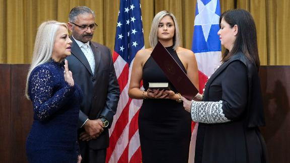 Justice Secretary Wanda Vazquez is sworn in as governor of Puerto Rico by Supreme Court Justice Maite Oronoz in San Juan on Wednesday.