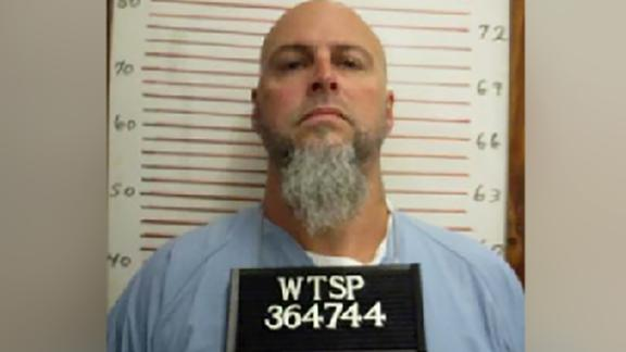 Escaped inmate at prison official's home before her death