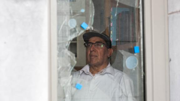 A caretaker at the Galway Maryam Mosque surveys damage from the July attack.