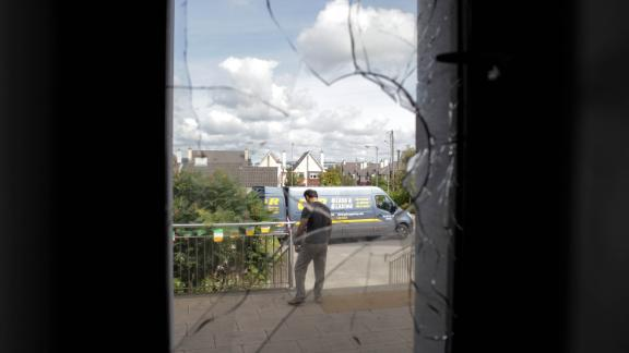 Ahmad Subhani, security officer at the Maryam Mosque in Galway, assesses damage from the July attack.