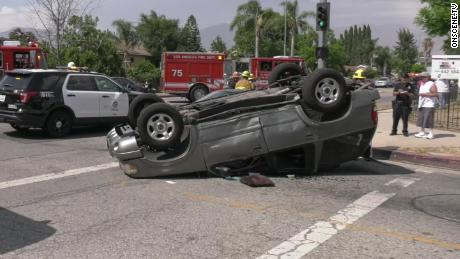 An car lies on its roof at the scene of Wednesday's accident.