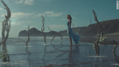 "A still from Taylor Swift's ""Out of the Woods"" video clip."