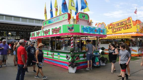 The Bacon Box serves Bacon Balls on a Stick, Bacon Pecan Pie on a Stick and other pork-themed delights at the Iowa State Fair' August 08, 2019 in Des Moines, Iowa.