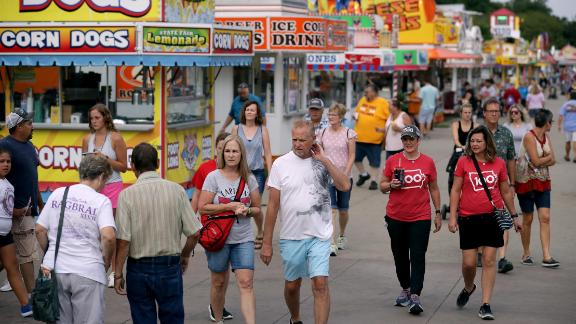 DES MOINES, IOWA - AUGUST 08: Fair-goers walk past the food venders lining Grand Avenue at the Iowa State Fair August 08, 2019 in Des Moines, Iowa. 22 of the 23 politicians seeking the Democratic Party presidential nomination will be visiting the fair this week, six months ahead of the all-important Iowa caucuses. (Photo by Chip Somodevilla/Getty Images)