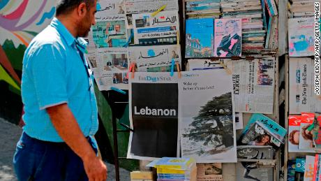 "A man looks at the front pages of the Lebanese local English-language newspaper ""The Daily Star"" in the capital Beirut on August 8, 2019, which refrained from publishing news articles in its print edition today in protest against the ""deteriorating situation"" in Lebanon."