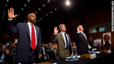 Roy Austin, left, appears in Congress during his time with the Obama administration. He remains frustrated at the nation's approach to hate crimes.