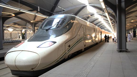 Saudi passengers walk in the platform at Mecca's train station on October 11, 2018 as the new high-speed railway line linking Mecca and Medina opens. - The Haramain High Speed Rail system will transport Muslim pilgrims, as well as regular travellers, 450 kilometres (280 miles) between the two cities via the Red Sea port of Jeddah in two hours. Thirty-five passenger trains capable of travelling at speeds of 300 kilometres per hour will slash the travel time from several hours to 120 minutes, transport officials said. The rail project, dogged by several delays, was built at a cost of more than $16 billion, according to Saudi media. (Photo by BANDAR ALDANDANI / AFP)        (Photo credit should read BANDAR ALDANDANI/AFP/Getty Images)