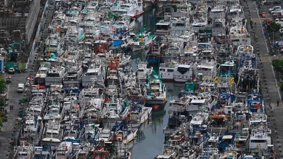 Fishing boats packed into the typhoon shelter in Nanfangao Harbour in Suao, Yilan county, Taiwan, as Typhoon Lekima approaches on August 8, 2019.