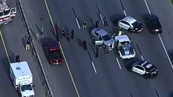 Shooter is on the run after killing 2 on a Houston freeway | WGN-TV