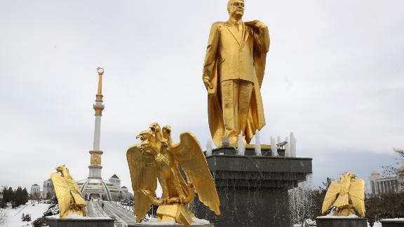 A golden staue of the first Turkmen president Saparmurat Niyazov, near the Independence Monument, in Ashgabat.