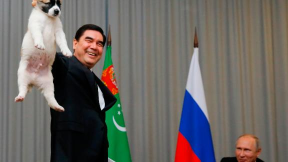 Turkmenistan's President Gurbanguly Berdymukhamedo holds up a puppy he intended to give to Russian President Vladimir Putin in the Black Sea resort of Sochi, Russia, in 2017.