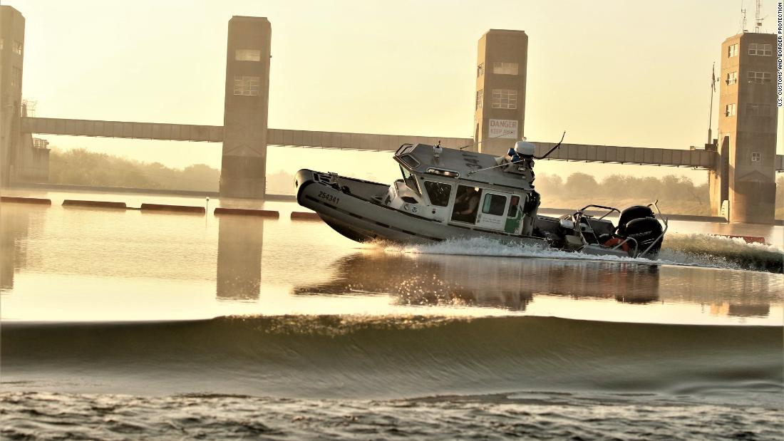 A US Border Patrol boat on the Rio Grande takes fire from the Mexican side