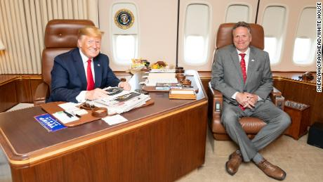 Alaska Gov. Mike Dunleavy met with President Trump aboard Air Force One on June 26 as the president's plane was on the tarmac in Alaska en route to the G20 summit in Japan.