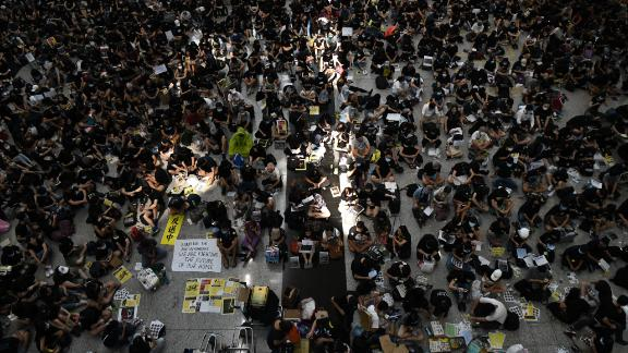 Protesters rally against a controversial extradition bill at Hong Kongs international airport on August 9, 2019. - Hundreds of pro-democracy activists, some wearing face masks and helmets, staged a sit-in at Hong Kong's airport on August 9 hoping to win support from international visitors for their movement. (Photo by Anthony WALLACE / AFP)        (Photo credit should read ANTHONY WALLACE/AFP/Getty Images)