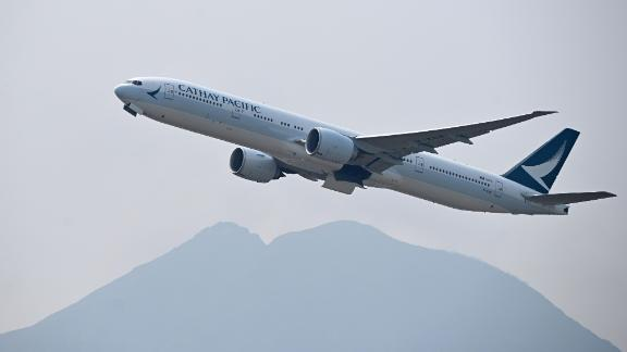 A Cathay Pacific passenger plane takes off from Hong Kong's international airport on March 13, 2019. (Photo by Anthony WALLACE / AFP)        (Photo credit should read ANTHONY WALLACE/AFP/Getty Images)