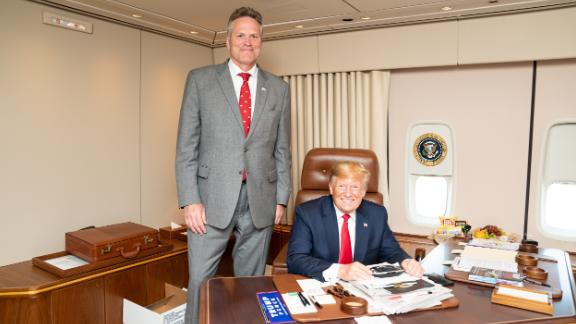 Alaska Gov. Mike Dunleavy met with President Trump aboard Air Force One on June 26.