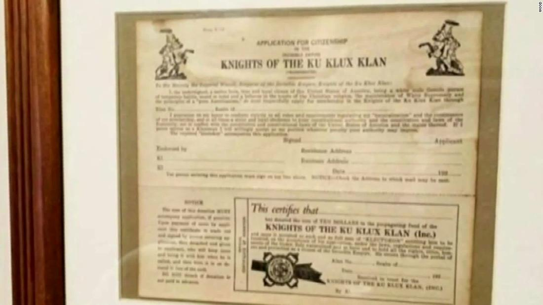 A police officer has been fired after KKK memorabilia was found in his Michigan home