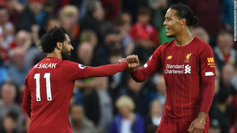 Mohamed Salah (L) celebrates with Liverpool's Dutch defender Virgil van Dijk after scoring in he 4-1 win over Norwich.